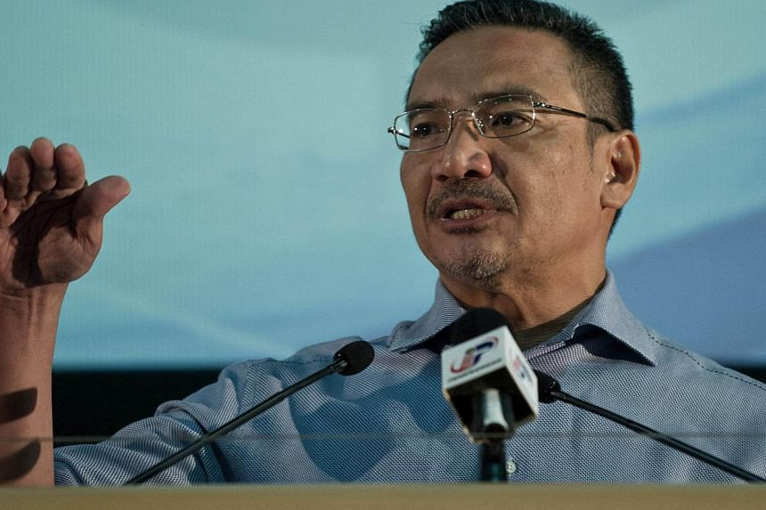 Malaysian Minister of Defence and Acting Transport Minister Hishammuddin Hussein delivers a statement to the media on the missing Malaysia Airlines flight MH370 at the Putra World Trade Center (PWTC) in Kuala Lumpur on April 5, 2014. Mr Hishammuddin