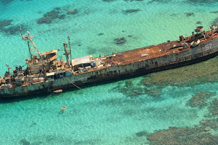 In this photo taken March 29, 2014, an aerial view shows a Philippines Navy vessel that has been grounded since 1999 to assert the nation's sovereignty over the Second Thomas Shoal, a remote South China Sea reef also claimed by China.China's ne