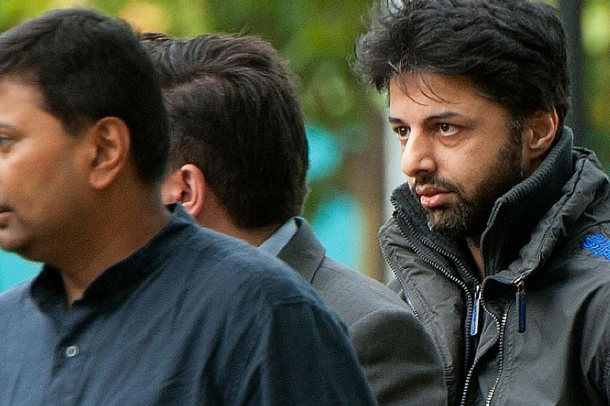 In this file picture taken on August 10, 2011 Shrien Dewani (right) arrives at Belmarsh Magistrates' Court sitting at Woolwich Crown Court in south London.South Africa formally charged extradited British businessman Shrien Dewani on Tuesday wit