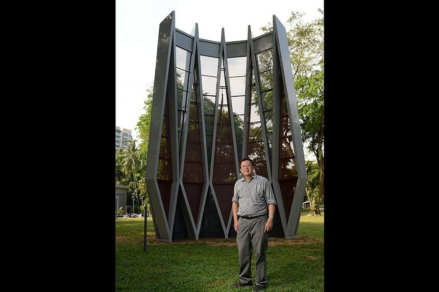 Architectural historian Lai Chee Kien with the steel structure, which depicts the facade of the iconic former National Theatre. -- PHOTO: ST FILE