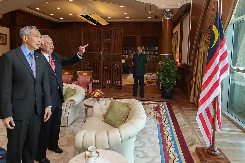Homes and a clubhouse in East Ledang, one of the developments in Nusajaya in Iskandar Malaysia in the southern Johor state.  Prime Minister Lee Hsien Loong with his Malaysian counterpart Najib Razak at the latter's office in Putrajaya yesterday. Both