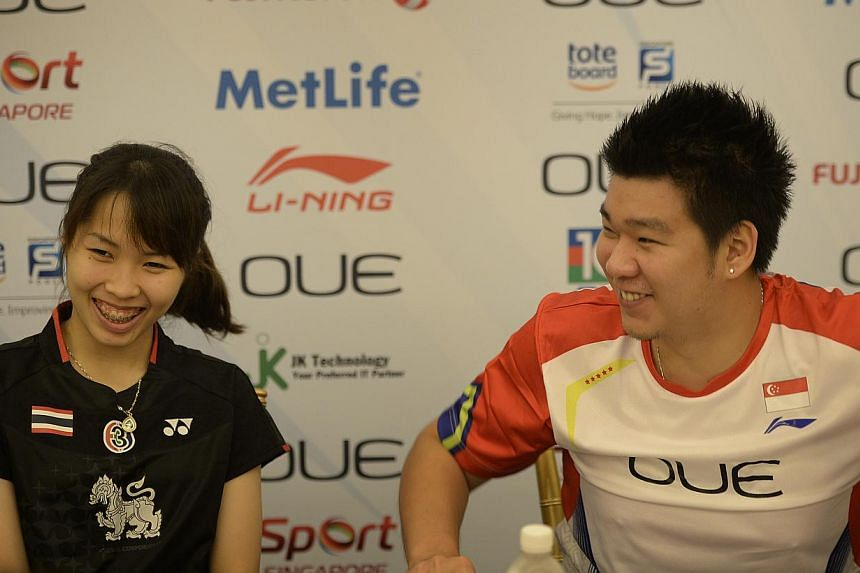 Thai badminton star Ratchanok Intanon (left) holding court at the OUE Singapore Open media conference yesterday, with Thai-born Singapore shuttler Chayut Triyachart acting as her translator. Ratchanok admitted she is coming to terms with the pressure