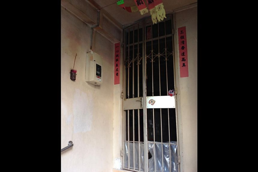 Mr Huang Jin Yin worked in a hardware shop but helped out regularly at the temple operating out of this flat (above) at Block 501 in Hougang Avenue 8. -- ST PHOTOS: NEO XIAOBIN, JOYCE LIM