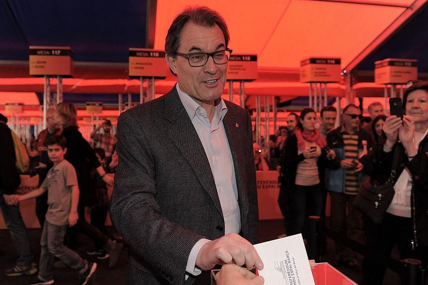 President of Catalonia and leader of the Catalan Convergence and Unity party (CiU) Artur Mas casts his ballot at the Camp Nou stadium in Barcelona on April 5, 2014 in a referendum by Barcelona football club partners for the renovation of the club's s