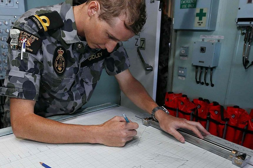 A Maritime Warfare Officer plots a course aboard the Australian Navy ship HMAS Perth for the distance to run with fuel to reach the search zone for the missing Malaysian Airlines flight MH370 in the southern Indian Ocean on April 8, 2014. -- PHOTO: R
