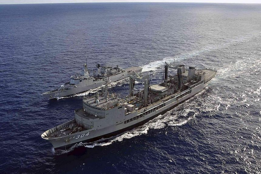 The Australian Navy ship HMAS Success (in the foreground) performing a replenishment at sea evolution with the Royal Malaysian Navy ship KD Lekiu, providing it with more fuel during the continuing search for the missing Malaysian Airlines flight MH37