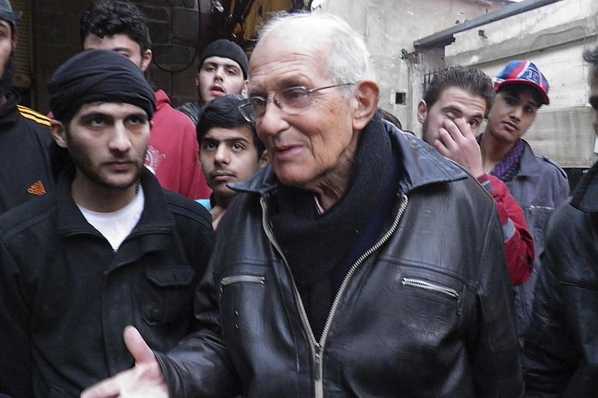 Dutch Jesuit Father Frans van der Lugt chats with civilians, urging them to be patient, in the besieged area of Homs, on Jan 29, 2014. -- FILE PHOTO: REUTERS
