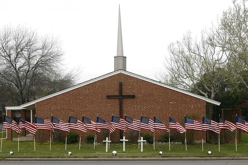 United States flags are pictured in front of the Central Christian Church in Killeen, Texas on April 3, 2014, where the Fort Hood Army Base is located. -- FILE PHOTO: REUTERS