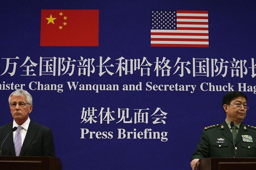 US Secretary of Defence Chuck Hagel (left) and Chinese Minister of Defence Chang Wanquan (right) attend a news conference at the Chinese Defence Ministry headquarters in Beijing on Tuesday, April 8, 2014.Visiting US Defence Secretary Chuck Hage