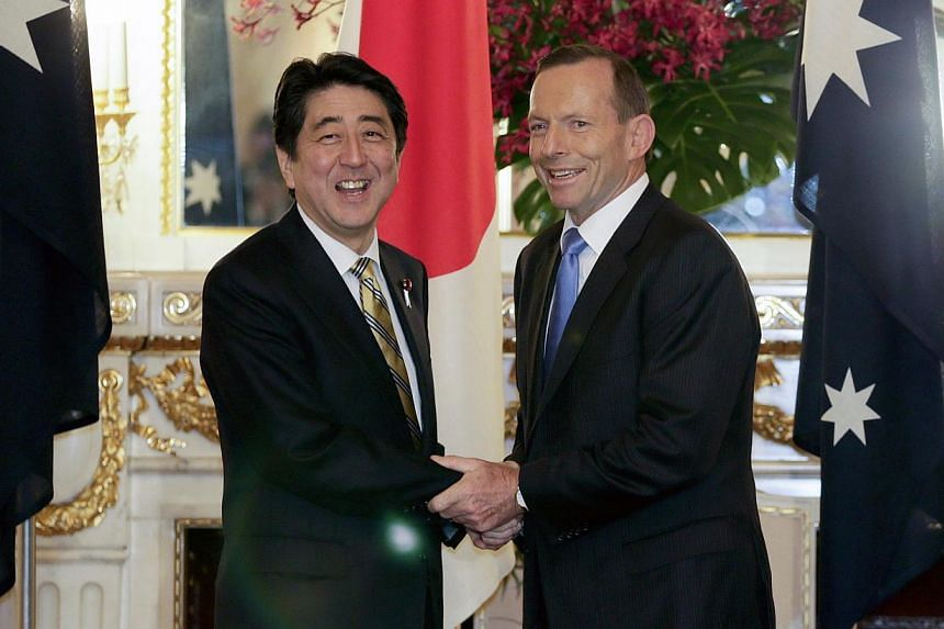 Australia's Prime Minister Tony Abbott (right) and Japan's Prime Minister Shinzo Abe at the start of summit talks at the state guest house in Tokyo on April 7, 2014. -- PHOTO: REUTERS