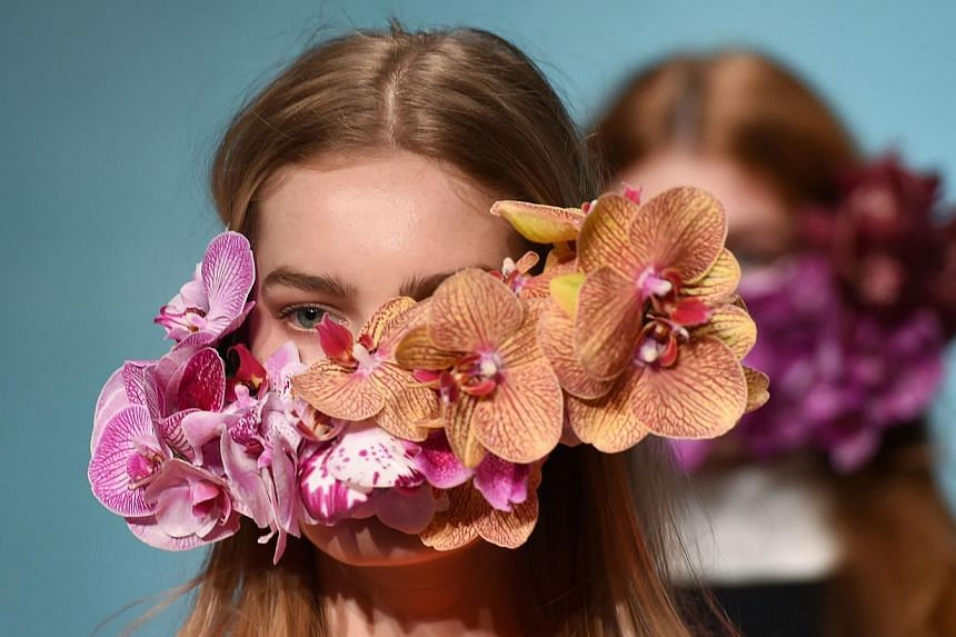 A model parades an outfit by Australian designer Toni Maticevski during a showing of his label Maticevski at Fashion Week Australia, in Sydney on April 8, 2014. -- PHOTO: AFP