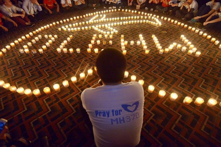 Chinese relatives of passengers on the missing Malaysia Airlines flight MH370 take part in a prayer service at the Metro Park Hotel in Beijing on April 8, 2014. -- FILE PHOTO: AFP
