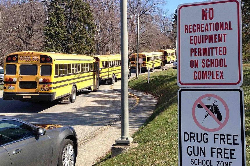 School buses are parked outside Franklin Regional High School after reports of stabbing injuries in Murrysville, Pennsylvania, on April 9, 2014. An American high school student stabbed or slashed 20 people, mostly teenagers, in a bloody 30-minut