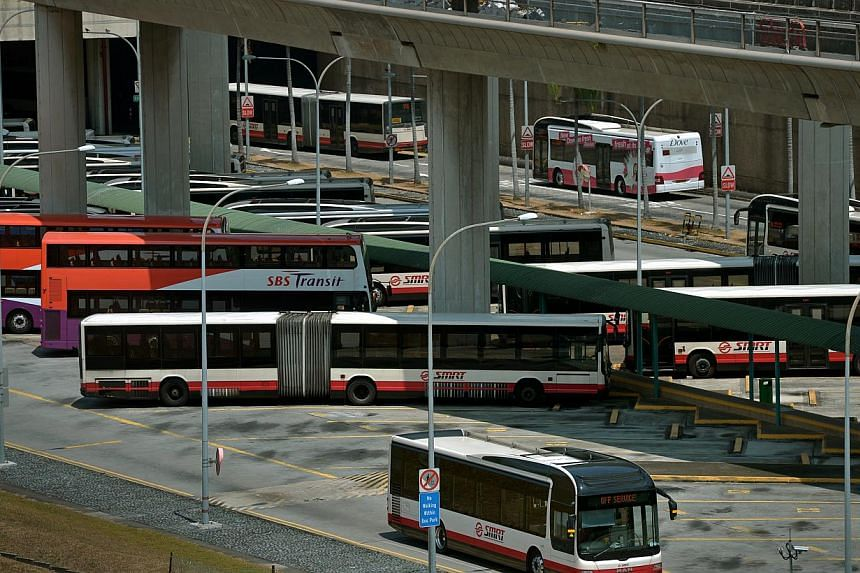 Buses at the Woodlands Regional Bus Interchange.A centralised bus fleet management system that will allow public transport operators to issue timely advisories to bus drivers will cost the Government $68 million to build and install. -- ST FILE