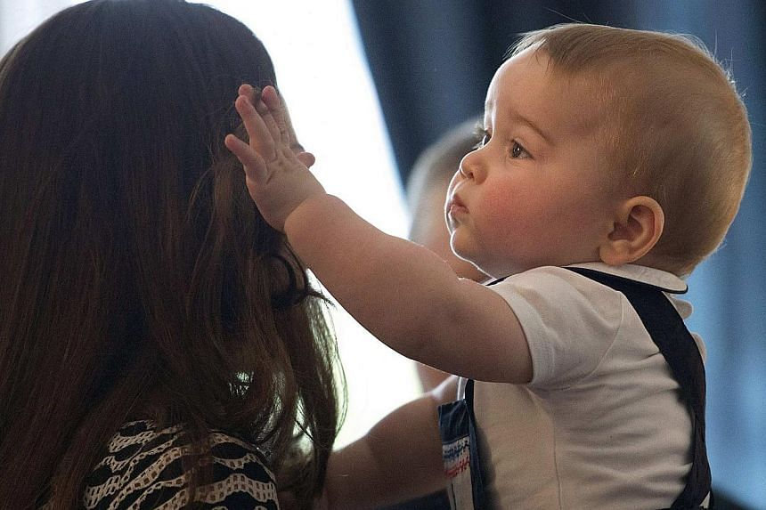 Catherine, Duchess of Cambridge, holds her son Prince George during a Plunket nurse and parents' group event at Government House in Wellington on April 9, 2014. -- PHOTO: REUTERS