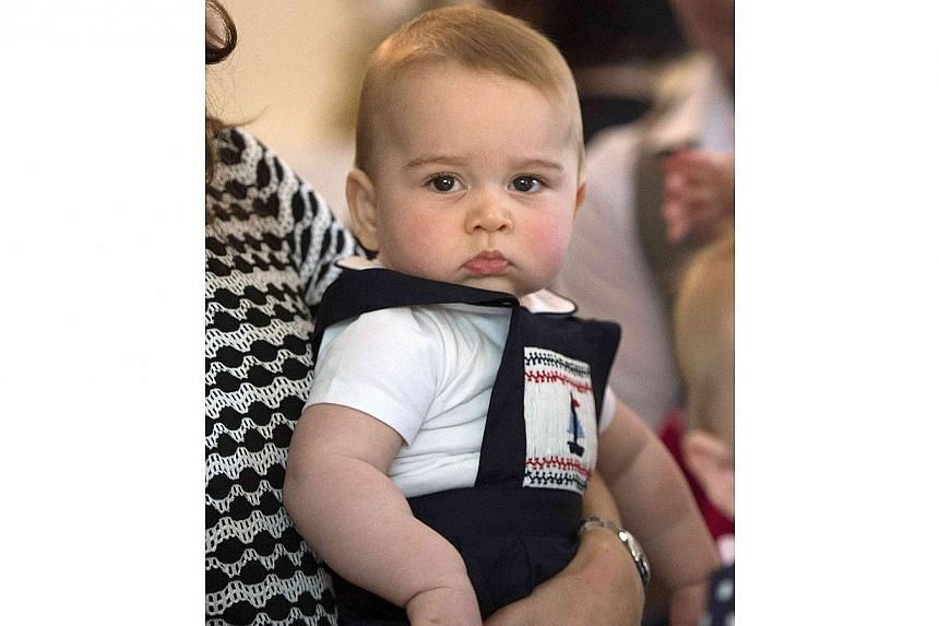 Britain's Prince George is seen while being carried by his mother Catherine, The Duchess of Cambridge, during a Plunket nurse and parents' group event at Government House in Wellington on April 9, 2014. -- PHOTO: REUTERS