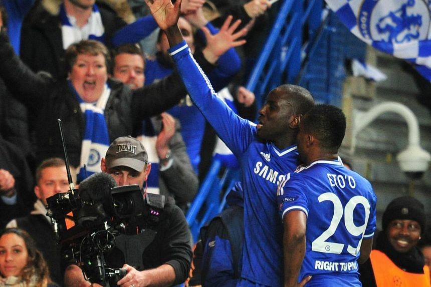 Chelsea striker Demba Ba (left) celebrates with teammate Samuel Eto'o after scoring their second goal during the Champions League quarter final second leg match against Paris Saint-Germain at Stamford Bridge in London on April 8, 2014. -- PHOTO: AFP&