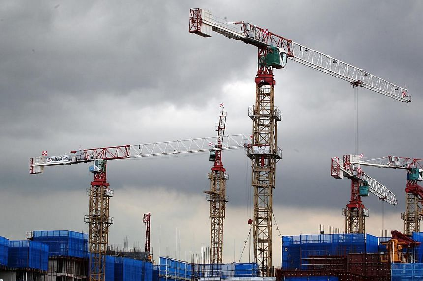 Videos, guidebooks and training courses will be rolled out to boost safety in three areas: work at heights, cranes and formwork. -- ST FILE PHOTO: JASON QUAH
