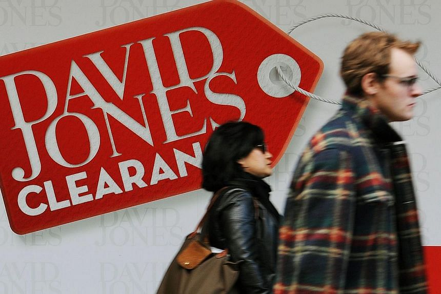 This file photo taken on June 29, 2012, shows shoppers walking past department store David Jones in central Sydney. David Jones announced on April 9, 2014, it intends to recommend a takeover offer from South African retailer Woolworths. -- FILE PHOTO