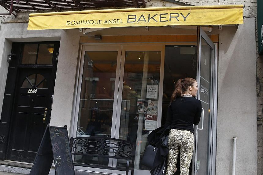 A woman waits to enter the Dominique Ansel Bakery in New York on April 8, 2014. -- PHOTO: REUTERS