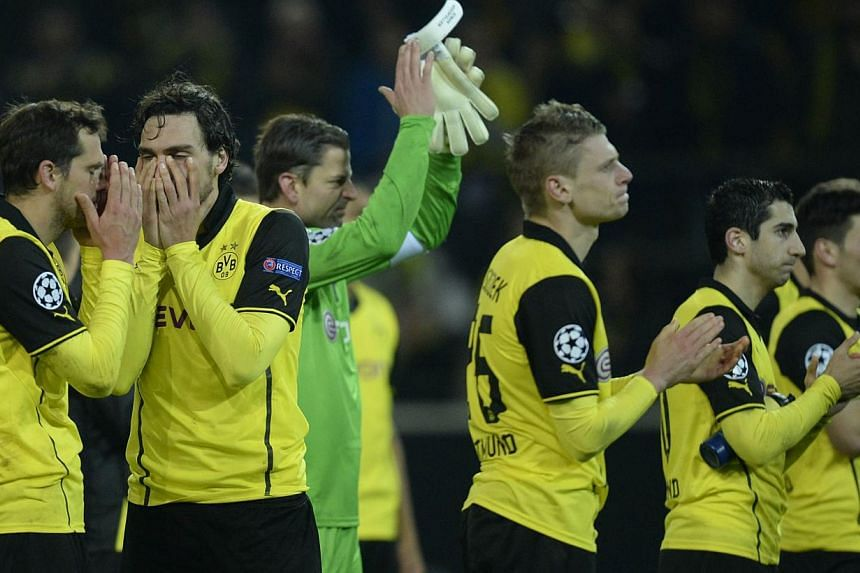 Dortmund players react after their Champions League quarter-final, second leg match against Real Madrid. -- PHOTO: AFP