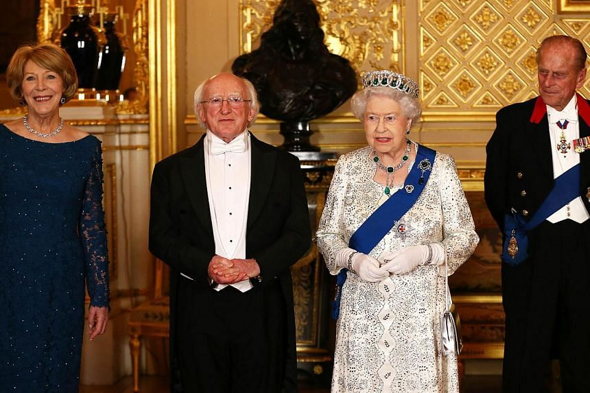 Irish President Michael D. Higgins (second, left) and Britain's Queen Elizabeth II (second, right) are flanked by Higgins's wife Sabina Coyne (left) and Britain's Prince Philip, Duke of Edinburgh (right) as they pose for a photograph ahead of a State