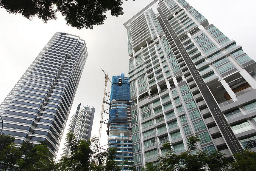 Private homes in Singapore changed hands at a faster pace last month, sending prices slightly higher as well. -- ST FILE PHOTO: DESMOND LUI