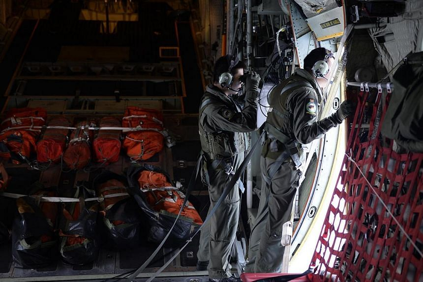 Personnel from the Republic of Singapore Air Force (RSAF) scanning the seas about 140 nautical miles north-east of Kota Baru, Kelantan, for any signs of a Malaysia Airlines (MAS) plane which went missing on March 8 2014.The figures alone are st