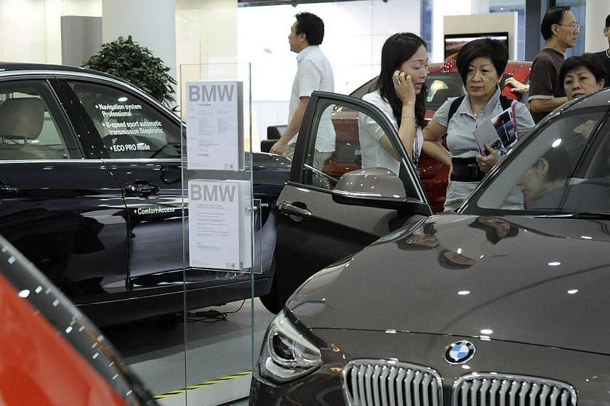Three out of five Certificate of Entitlement (COE) categories ended higher on Wednesday, April 9, 2014, despite the prospect of a bigger supply of certificates from next month.-- ST FILE PHOTO:MARK CHEONG