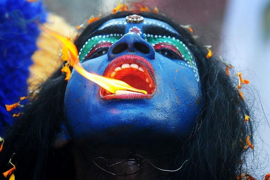 An Indian artist dressed as the Hindu goddess Kali participates in a procession to celebrate the Ram Navami festival in Allahabad on April 8, 2014. Hindu devotees celebrate the festival of Ram Navami, the birth anniversary of Lord Rama, across India,