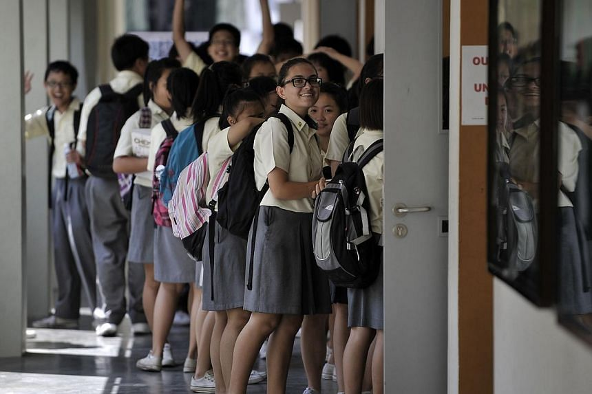 Peirce Secondary students waiting to enter a homeroom for their next lesson.As Singapore reviews its education system to address criticisms of excessive stress and competitition, Prime Minister Lee Hsien Loong yesterday sought to put things in