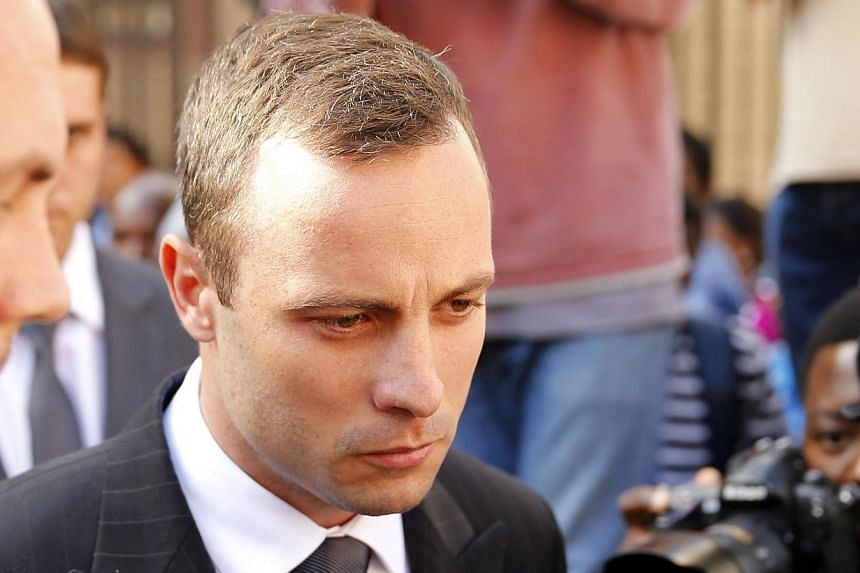 Olympic and Paralympic track star Oscar Pistorius reacts at the end of his trial at the North Gauteng High Court in Pretoria April 10, 2014.South African state prosecutor Gerrie Nel continued his fierce cross-examination of Oscar Pistorius on T