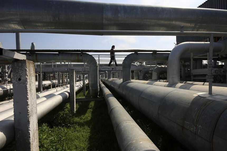 A man walks across pipes from an underground gas storage facility of the Chernomorneftegaz company in the village of Glebovka, in Crimea's Chernomorsky district, April 9, 2014. Pressident Vladimir Putin on Thursday sent a letter to leaders of 18