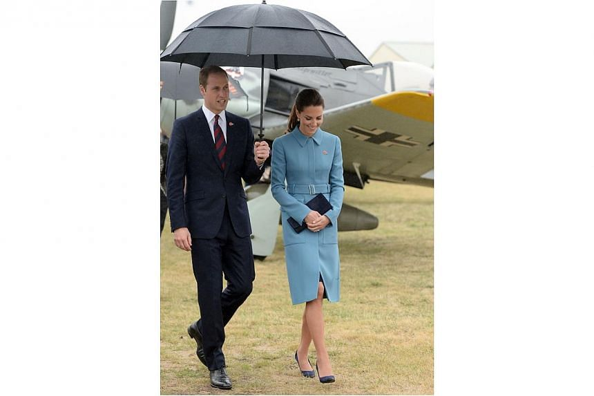 Britain's Catherine, Duchess of Cambridge looks at a static WWI display, with her husband Prince William, at the Omaka Aviation Heritage Centre near Blenheim, in New Zealand April 10, 2014. -- PHOTO: REUTERS