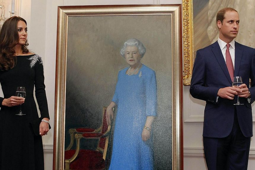 Britain's Prince William (Right) and his wife Catherine, the Duchess of Cambridge (Left), stand next to a picture of Britain's Queen Elizabeth II as they attend an art unveiling ceremony at Government House in Wellington on April 10, 2014. -- PHOTO: