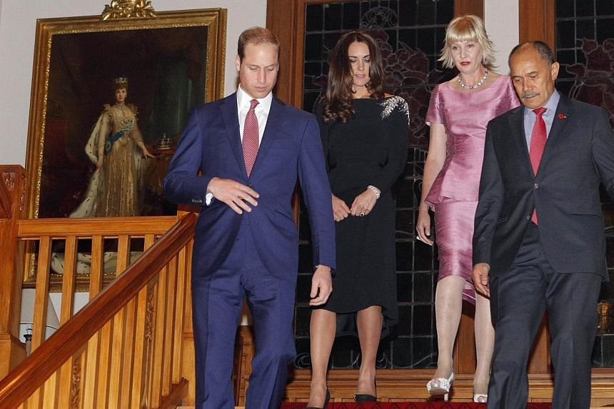Britain's Prince William and his wife Catherine, the Duchess of Cambridge, arrive with New Zealand Governor-General Jerry Mateparae and his wife Janine for an art unveiling ceremony and reception at Government House in Wellington on April 10, 2014. -