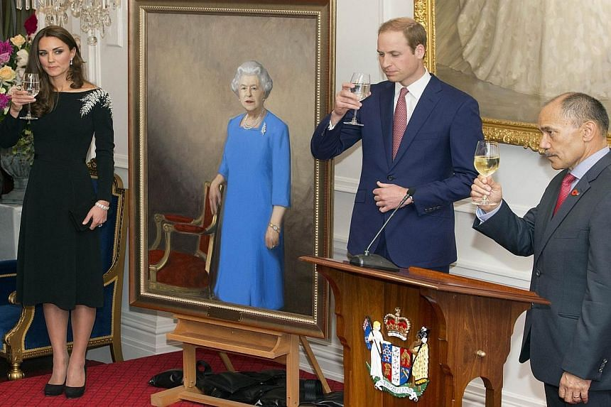 New Zealand's Governor-General Jerry Mateparae (Right) toasts with Britain's Prince William (Center) and his wife Catherine, the Duchess of Cambridge (Left) as they unveil a portrait of Queen Elizabeth II by New Zealand artist Nick Cuthell (not pictu