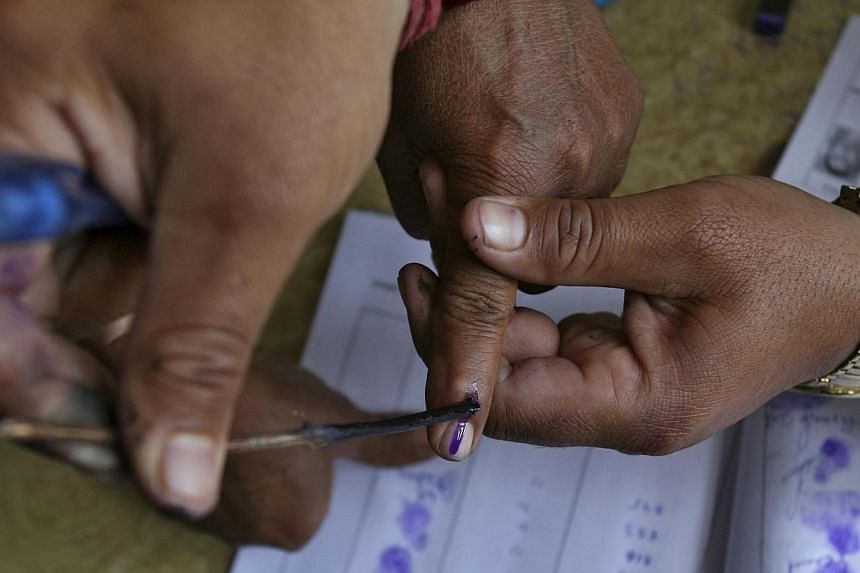 A polling officer applies ink on the finger of a voter at a polling station on the outskirts of Jammu April 10, 2014.Showing the finger can get you a punch in the face in many parts of the world. In India, during this general election at least,