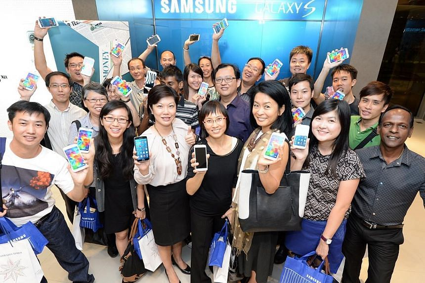 Twenty lucky winners walked away with the much-awaited Samsung Galaxy S5 LTE and a multi-function watch that connects to it. -- PHOTO: AZIZ HUSSIN