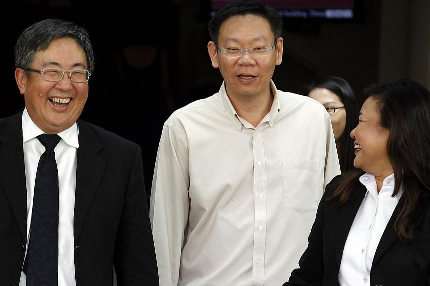 Mr Ng (centre) with his lawyers, Senior Counsel Tan Chee Meng and Ms Melanie Ho, after he was acquitted yesterday.
