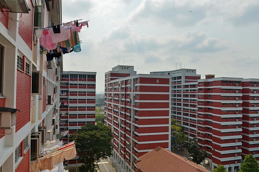 Previously, buyers of resale HDB flats knew the cash premium they were committing to when they agreed a price. Now they do not, making them more cautious in their offers, and a property agent says it has become a guessing game. -- ST PHOTO: CAROLINE