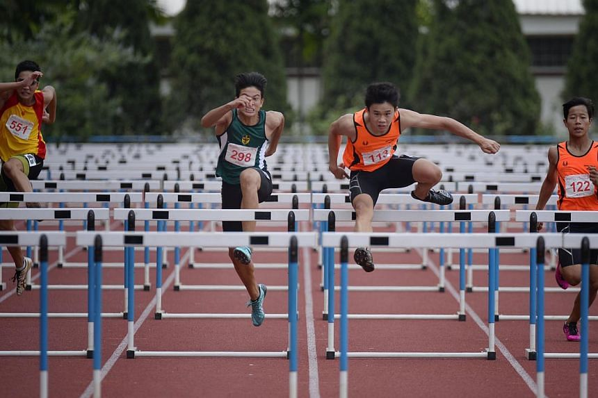 Jay Choo of Singapore Sports School (second from right) en-route to winning the Schools' National B Division 110m hurdles at Choa Chu Kang Stadium on April 8.-- ST FILE PHOTO: MARK CHEONG
