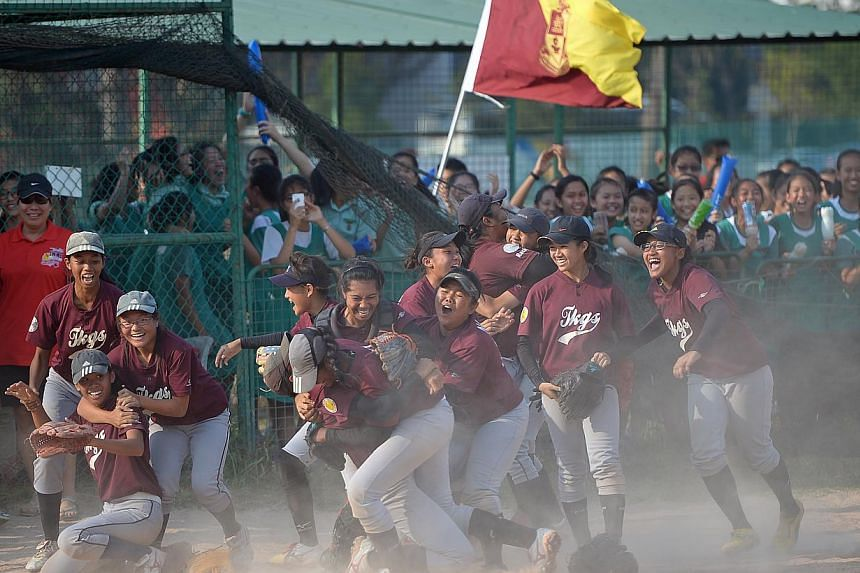 Tanjong Katong Girls' School celebrating after beating St Theresa's Convent 8-5 in the Schools' National B Division softball finals on April 11.-- ST FILE PHOTO: DESMOND WEE