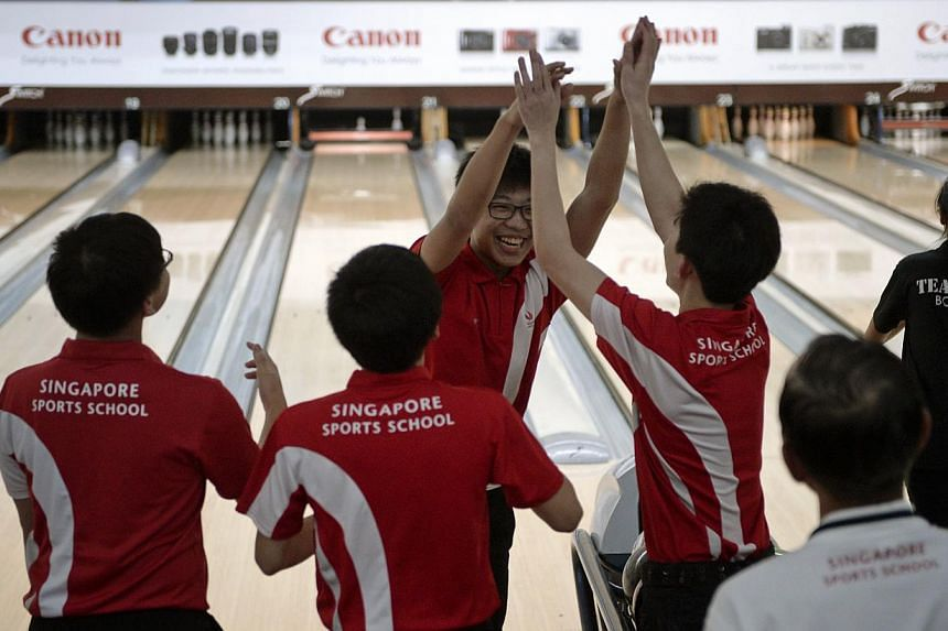 Singapore Sports School bowler Keith Tan celebrates with his team who clinched the quartet title during the last round of the Schools National B Division bowling finals held at Orchid Country Club on March 6.-- ST FILE PHOTO: MARK CHEONG
