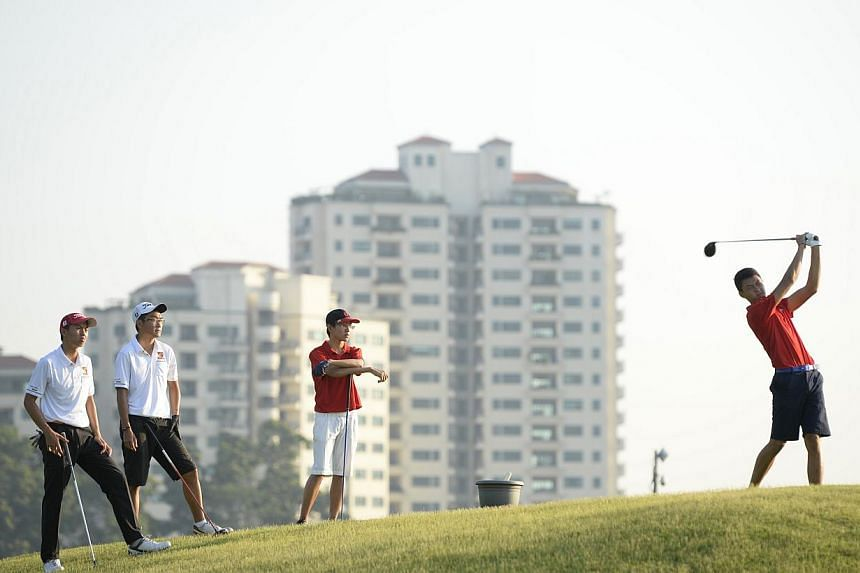 Boys golfers from the A Division on the greens at Marina Bay Golf Course at the Schools' National Golf Team Championships on April 9. Anglo-Chinese Junior College swept both boys and girls A Division titles.-- ST FILE PHOTO: DESMOND LIM