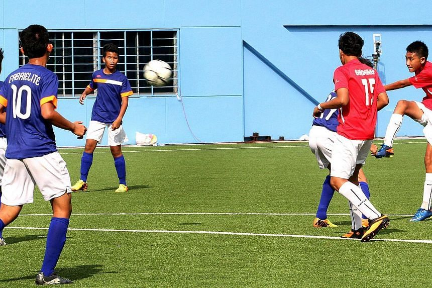 Muhammad Nazi (right) of Bendemeer Secondary School scoring the only goal of the game with a half-volley in the final of the South Zone C Division Inter School Football Tournament at the Jalan Besar Stadium on March 24.-- ST FILE PHOTO: LAU FOO