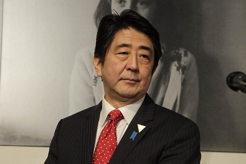 Japanese Prime Minister Shinzo Abe visits the Anne Frank House in Amsterdam on March 23, 2014. -- FILE PHOTO: AFP