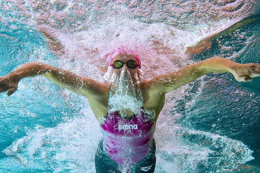 This picture taken with an underwater camera shows Charlotte Bonnet competing in the 100m breast stroke semi-final on April 9, 2014, during the French Swimming Championships in Chartres. -- PHOTO: AFP