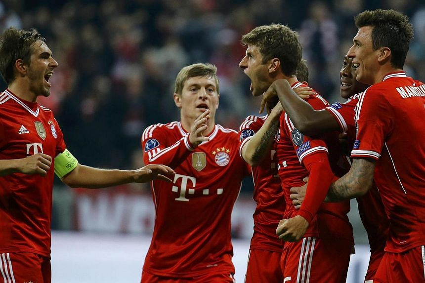 (From left) Bayern Munich's Philipp Lahm, Toni Kroos, Thomas Mueller, David Alaba and Mario Mandzukic celebrate Mueller's goal against Manchester United during their Champions League quarter-final second leg soccer match in Munich on April 9, 2014. -