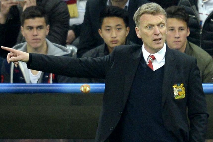 David Moyes said his focus was on building a team to get Manchester United back in the Champions League after they lost to Bayern Munich in the quarter-finals on Wednesday, all but ending their hopes of playing in next season's competition. -- PHOTO: